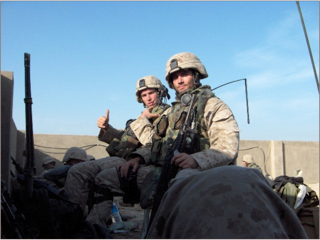 Elliot Ackerman (left) calls in an airstrike during the battle of Fallujah in April 2004. Photo courtesy of Elliot Ackerman