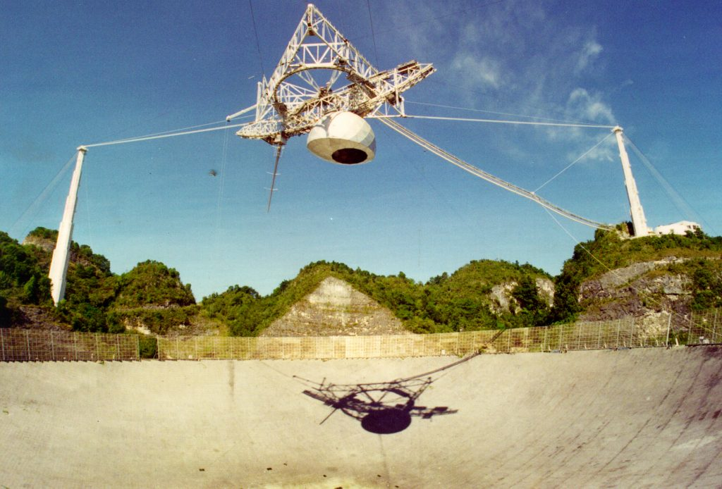 A 900-ton platform is suspended 450 feet above Arecibo's primary reflector dish. The dome, which carries receivers, can move along arched tracks, expanding the observatory's view of the sky.  Photo courtesy of the NAIC - Arecibo Observatory, a facility of the NSF