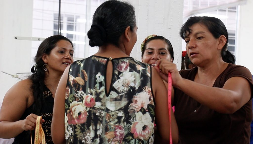The Colombian Agency for Reintegration runs sewing workshops to train women for jobs. Screen image by Debora Silva
