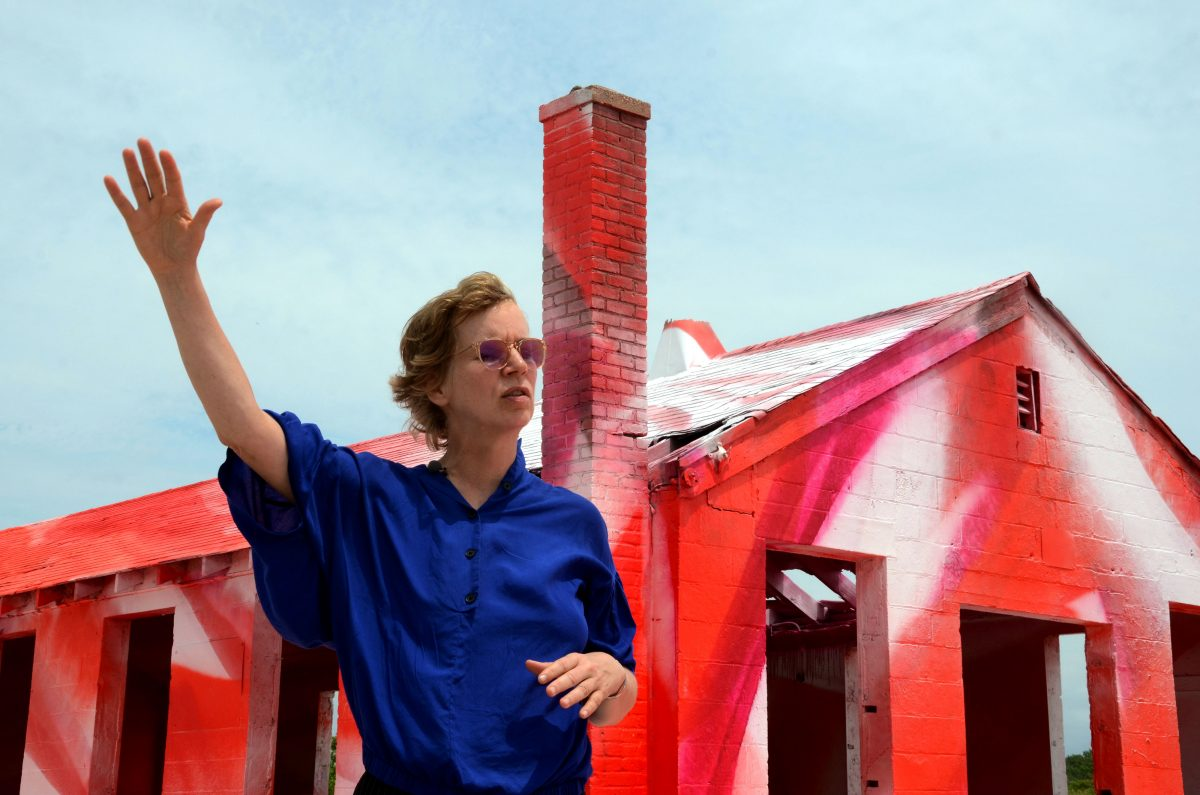Artist Katharina Grosse appears next to her piece in the Rockaways in Queens, New York. Photo by Andi Wang/PBS NewsHour