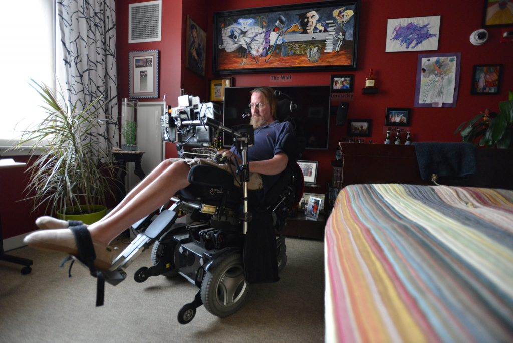 Steve Saling, a retired landscape architect, sits in his room. Here, he can control the window shade, television, and door with subtle movements of his face. Photo by Josh Reynolds for STAT