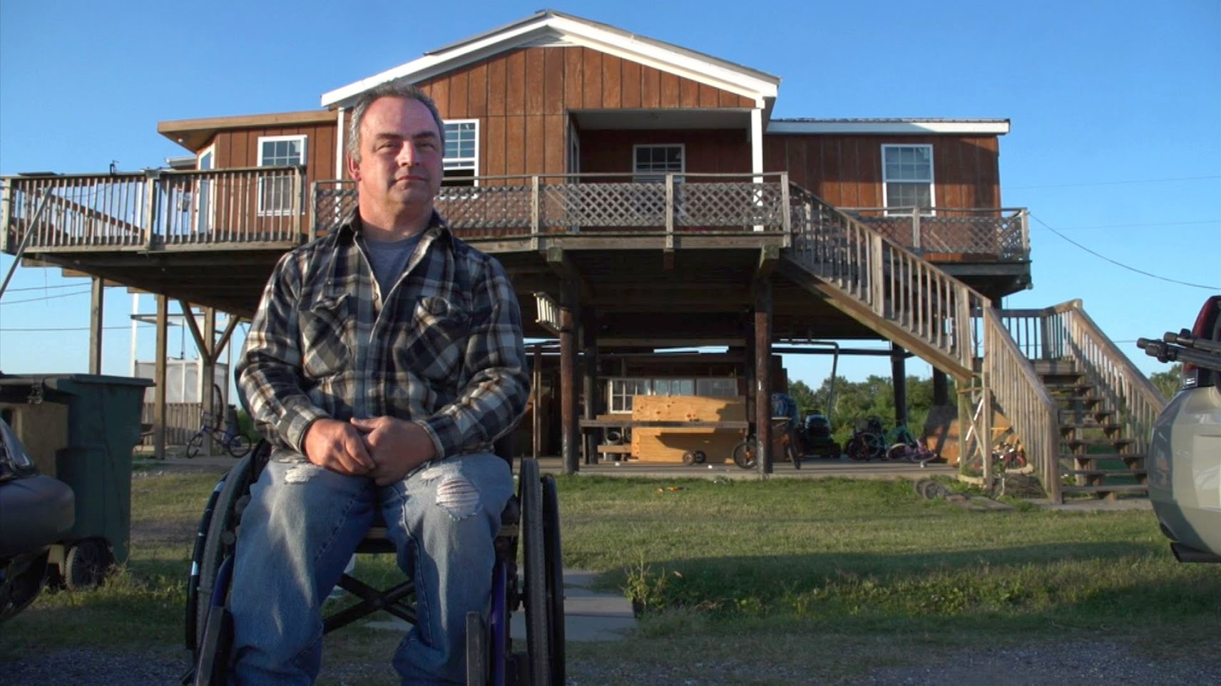 Chris Brunet appears outside of his home in 2012. He has lived on Isle de Jean Charles in coastal Louisiana his whole life. Photo by PBS NewsHour