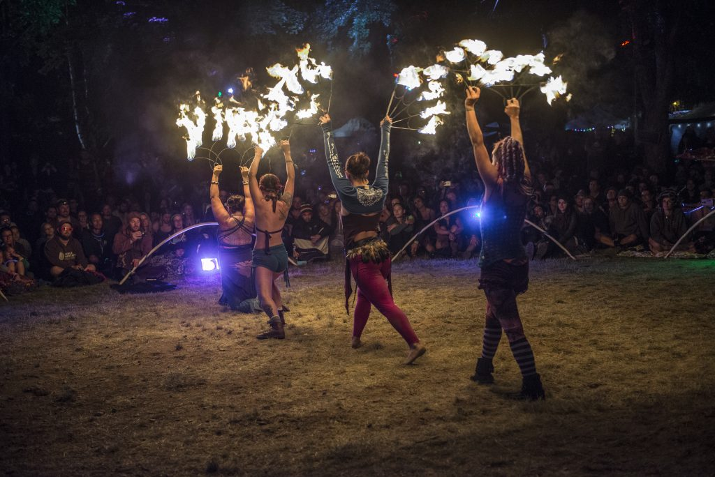 Fire dancers perform for a night crowd at the 26th Annual High Sierra Music Festival. Photo by Stuart Levine/High Sierra