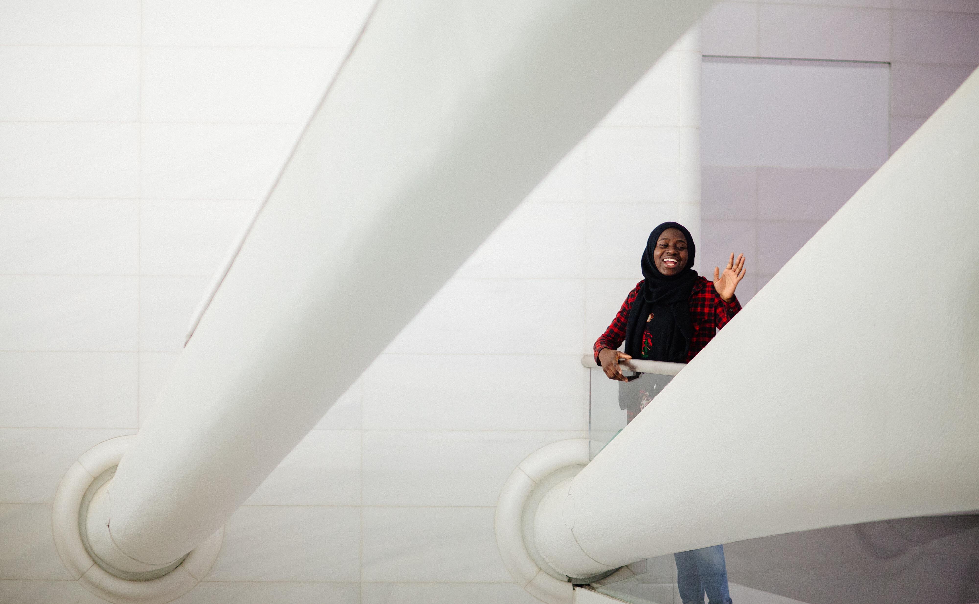 NYU Junior Mariyamou Drammeh waves to the camera. Photo by Emilio Madrid-Kuser