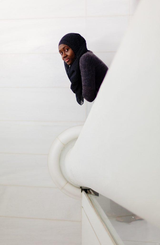 NYU Junior Isatou Daffeh looks into the camera. Photo by Emilio Madrid-Kuser