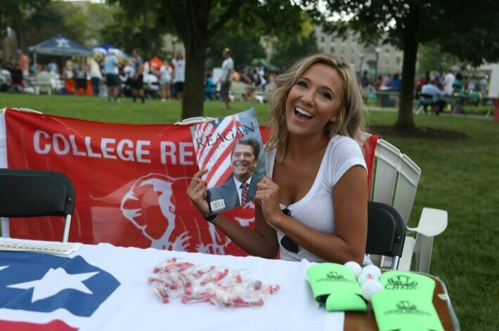 Kennedy Copeland, president of Xavier University College Republicans, holds a picture of Ronald Reagan at the Xavier University Involvement Fair. Picture courtesy of Kennedy Copeland