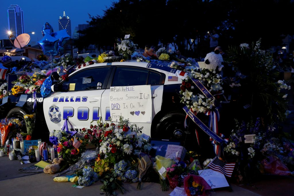 A makeshift memorial at Dallas Police Headquarters is seen one day after a lone gunman ambushed and killed five police officers at a protest decrying police shootings of black men, in Dallas, Texas, U.S., July 8, 2016. Photo By Shannon Stapleton/Reuters