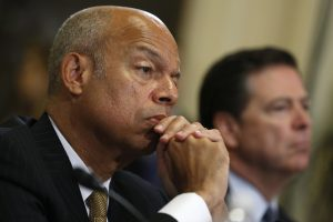 U.S. Homeland Security Secretary Jeh Johnson (L) and FBI Director James Comey listen to opening remarks during a House Homeland Security Committee hearing on Capitol Hill in Washington, U.S., July 14, 2016. REUTERS/Jonathan Ernst - RTSHXCW