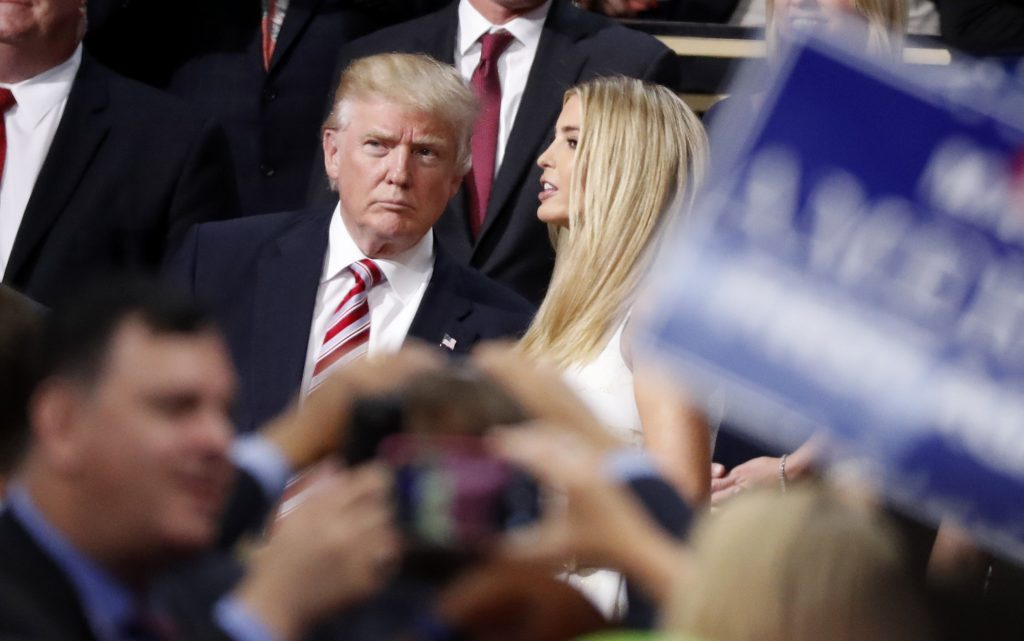 Republican presidential nominee Donald Trump talks to his daughter Ivanka in the Trump family box at the conclusion of former rival candidate Sen. Ted Cruz's address during the third night of the Republican National Convention in Cleveland, Ohio on July 20, 2016. Photo by Mark Kauzlarich/Reuters