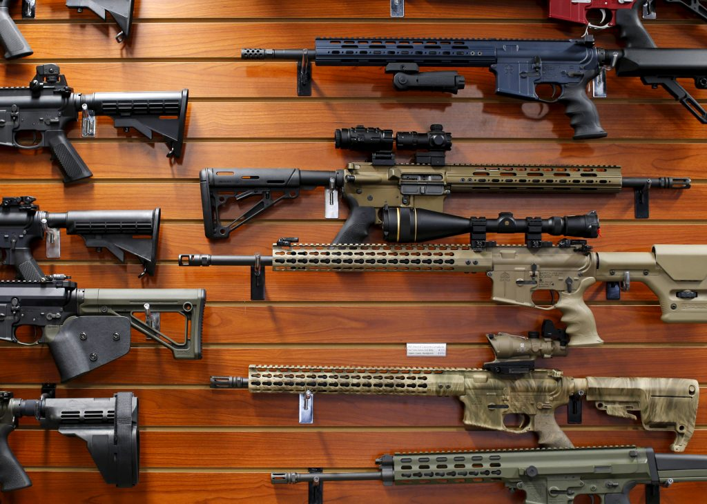 "Firearms are shown for sale at the AO Sword gun store in El Cajon, California, January 5, 2016. President Barack Obama said on Monday his new executive actions to tighten gun rules were ""well within"" his legal authority and consistent with the U.S. right to bear arms, a warning to opponents who are likely to challenge them in court. REUTERS/Mike Blake - RTX2167B"
