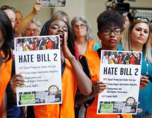 "Members of the black community shout out their opposition to North Carolina's HB2 ""bathroom law"" during a demonstration inside the state legislature in Raleigh"