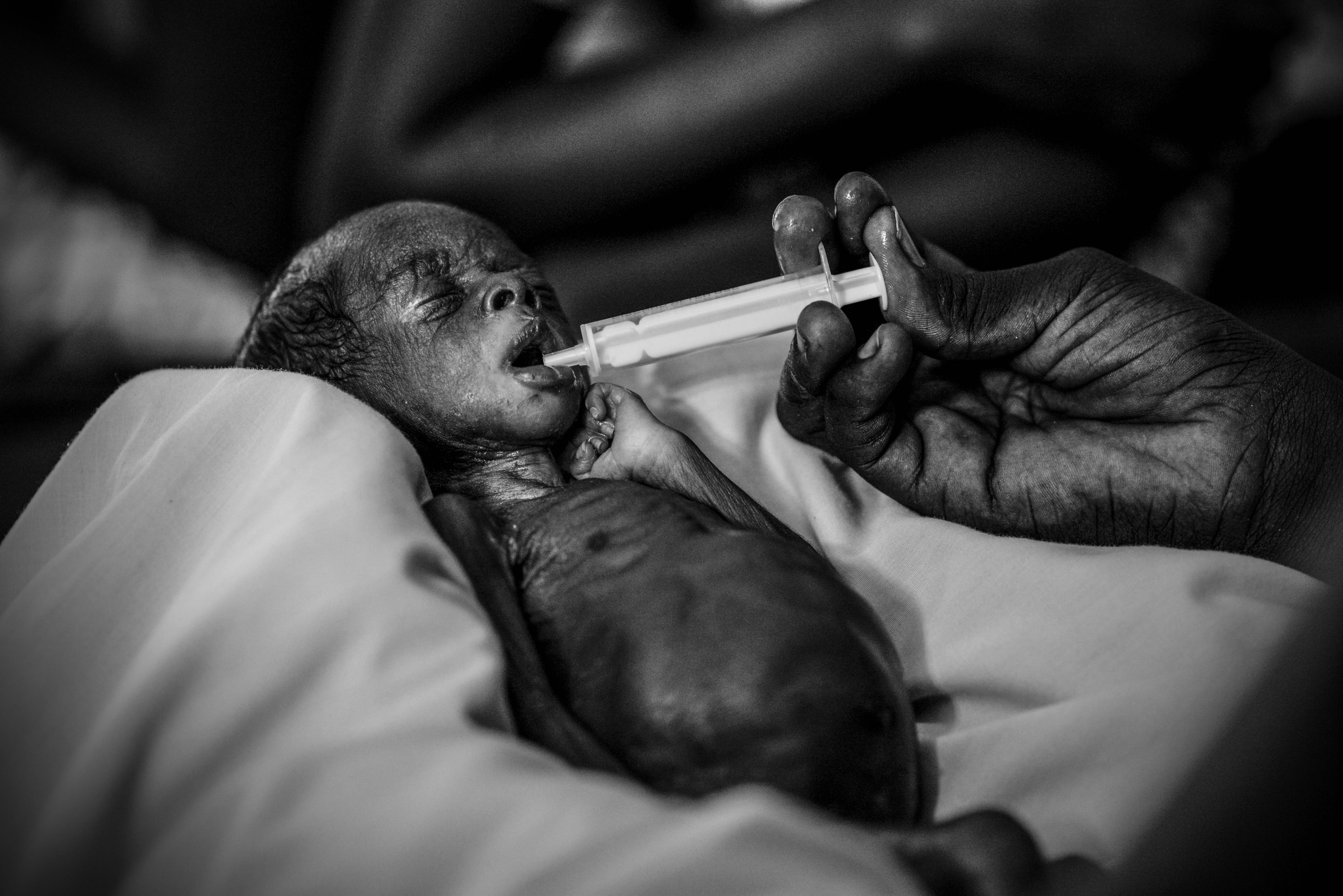 A premature baby is fed baby formula by syringe in a hospital near Juba, South Sudan. Photo by Sebastian Rich for UNICEF
