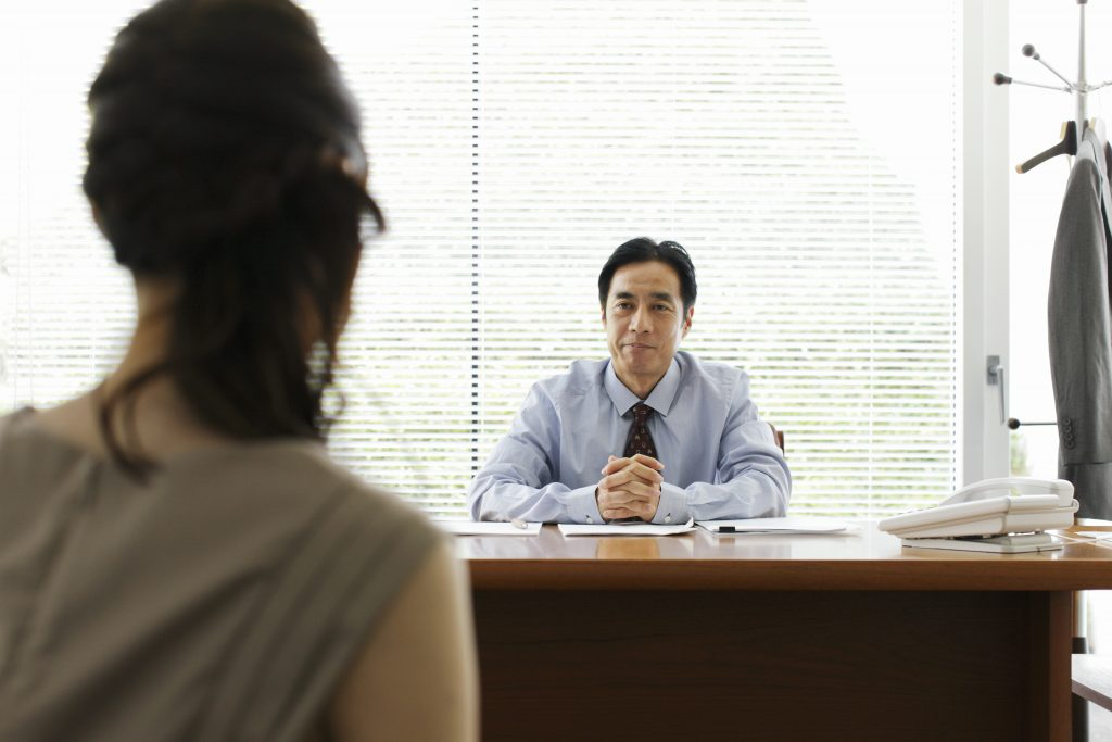 Mature businessman and businesswoman talking in office.Yokosuka Museum of Art,Kanagawa Prefecture,Japan. related words: job interview, jobs, job, job search Photo by sot via Getty Images.