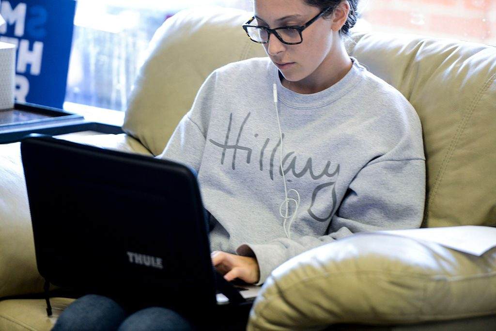 ARLINGTON, VA - AUGUST 27: A Hillary Clinton supporter works on a laptop at the Virginia Victory Coordinated Campaign Field Office August 27, 2016 in Arlington, Virginia. (Photo by Leigh Vogel/Getty Images)