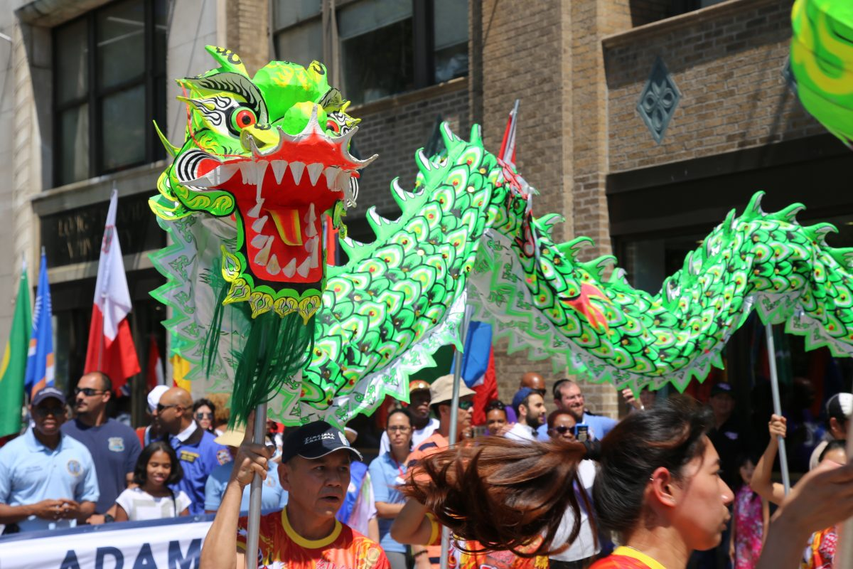 The Chinese delegation flies a dragon at the start of the parade at the 3rd annual International Day of Friendship celebration in Brooklyn, NY, on August 7, 2016. Photo by Omar Etman/PBS NewsHour Weekend