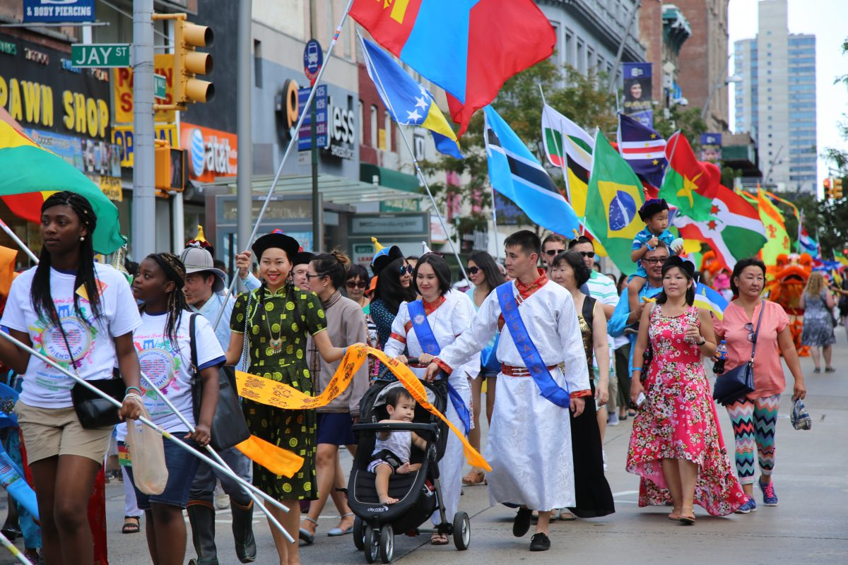 Marchers during the 3rd annual International Day of Friendship celebration in Brooklyn, NY, on August 7, 2016. Photo by Omar Etman/PBS NewsHour Weekend