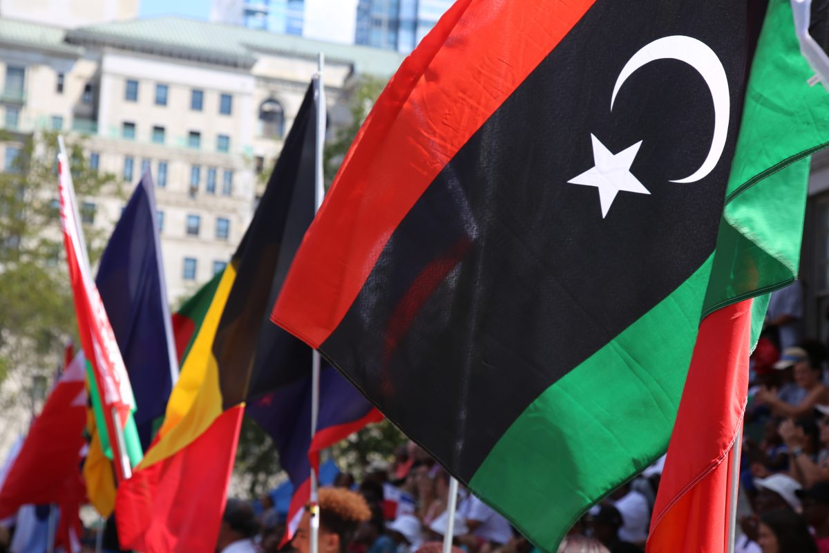 The flag of Libya in the row of 195 flags represented at the 3rd annual International Day of Friendship celebration in Brooklyn, NY, on August 7, 2016. Photo by Omar Etman/PBS NewsHour Weekend