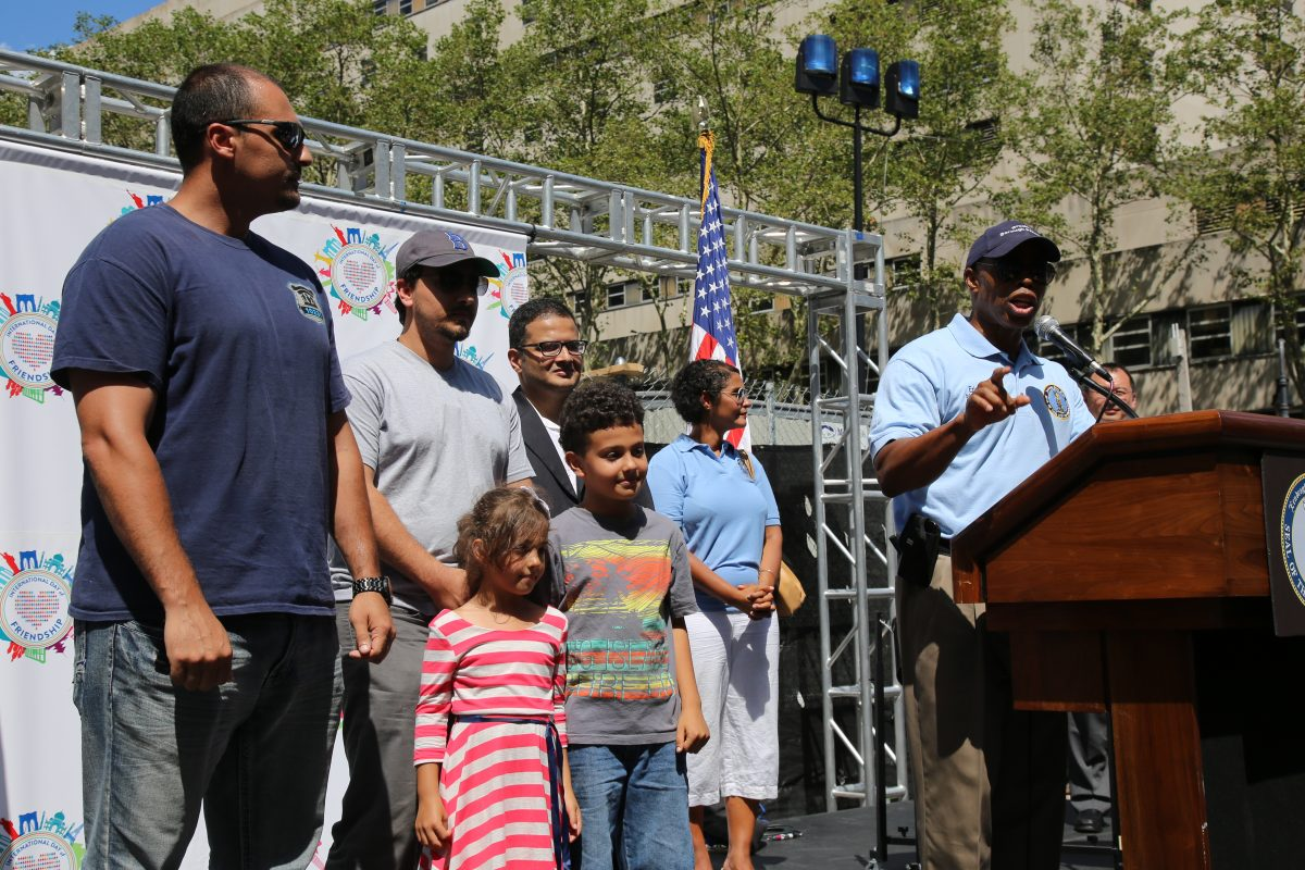 Borough President Eric L. Adams (R) introduces three Muslim-American veterans to the crowd at the 3rd annual International Day of Friendship celebration in Brooklyn, NY, on August 7, 2016. Photo by Omar Etman/PBS NewsHour Weekend