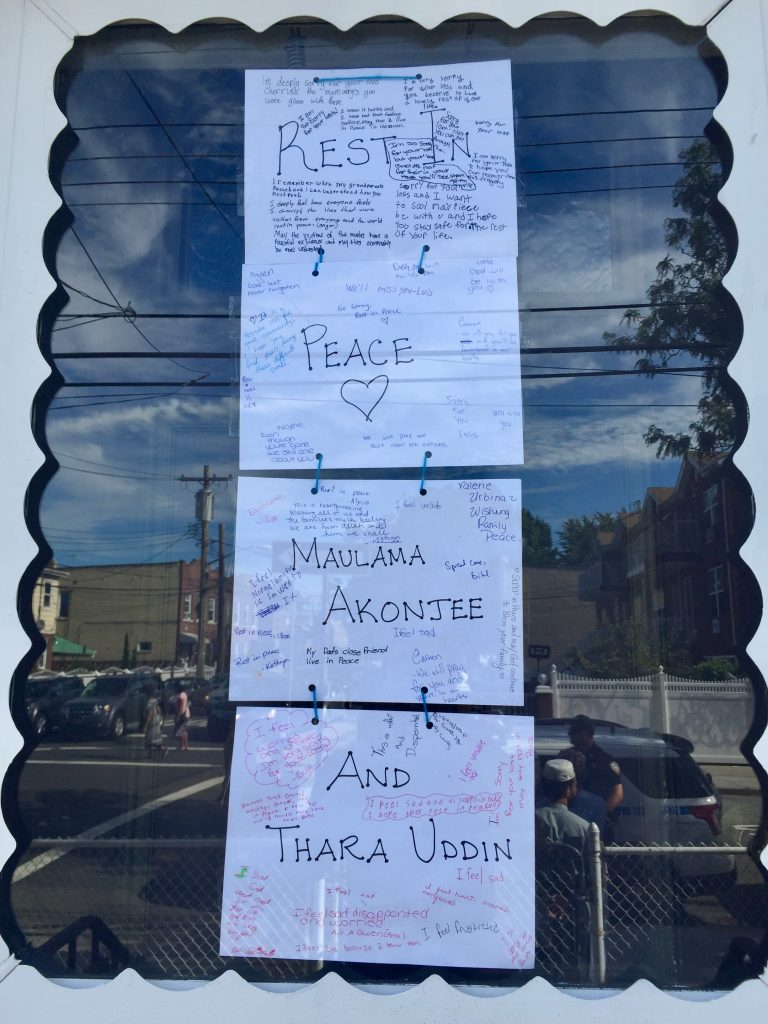 Signs made by students at the Arabic school down the road were placed on the side door to Al-Furqan Jame Masjid in Queens, New York, on August 17, 2016. Photo by Omar Etman/PBS NewsHour Weekend