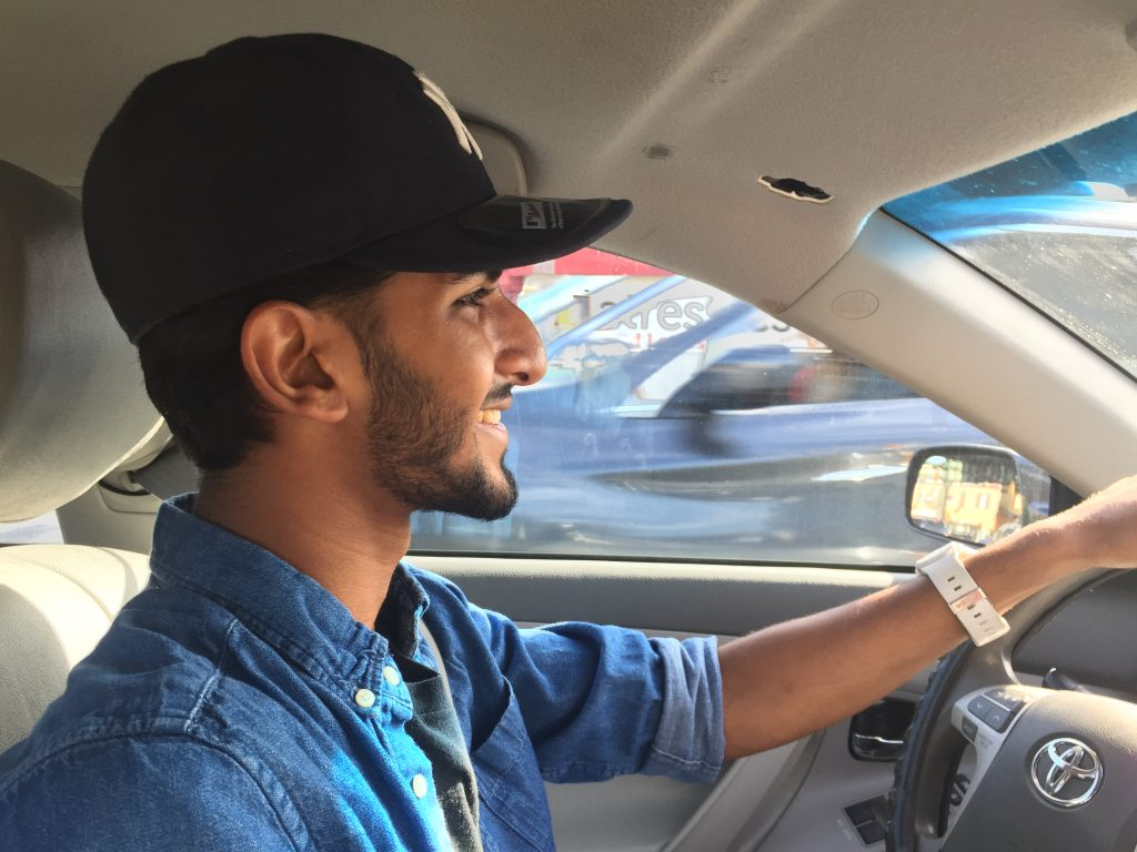 Shakhawat Saimoon, 18, driving around his neighborhood on the border of Brooklyn and Queens, New York, on August 17, 2016. Photo by Omar Etman/PBS NewsHour Weekend