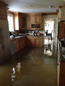 Flood waters began entering the author's parent's home early in the morning on August, 14th.