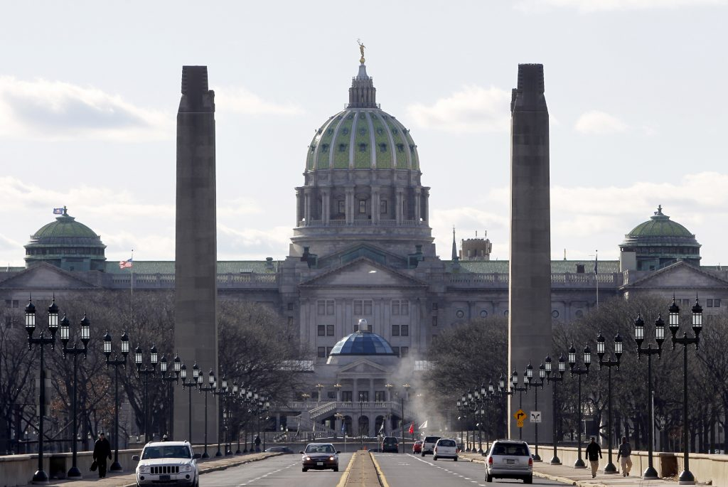 A view of the Pennsylvania State house from the State Street bridge in Harrisburg, Pennsylvania, January 18, 2012. The Keystone State's capital city faces a $317 million debt that accumulated after a municipal incinerator was repaired and retrofitted in 2003. After Harrisburg's attempt to file bankruptcy was rejected by a judge last fall, Pennsylvania's governor installed a receiver that has sole authority over how tax dollars are spent. Compounding the financial mess, the city council and mayor barely speak, little money is available for routine road and streetlight repairs, and high crime and poor schools have fueled suburban flight.REUTERS/Tim Shaffer