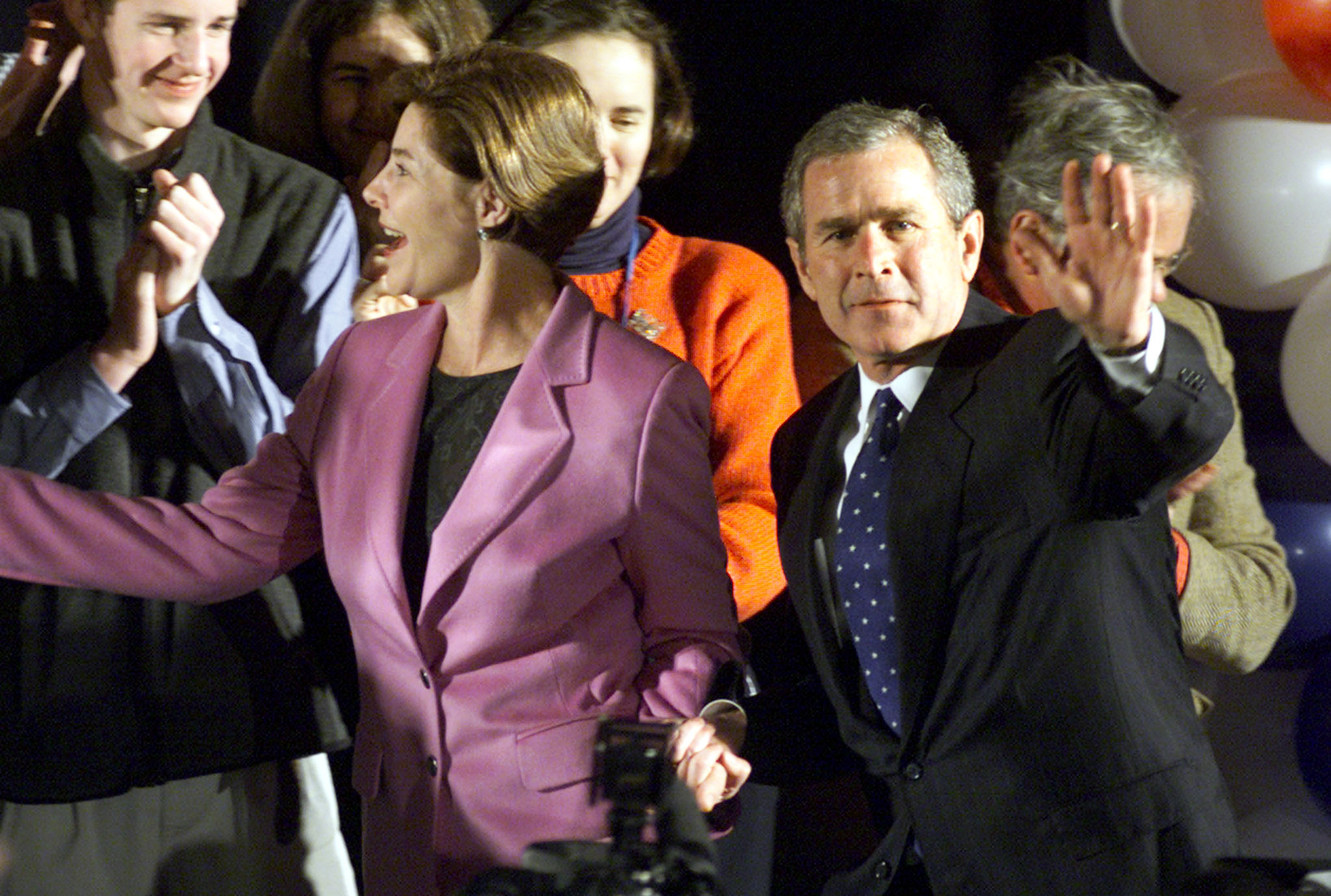 Republican presidential candidate George W. Bush appears on stage with his wife Laura at a rally of his supporters at St. Anselm College in February 1, after coming in a distant second to Arizona Senator John McCain in the New Hampshire Republican primary election. New Hampshire's primary is the first presidential primary of the 2000 election. MS - RTRUX8