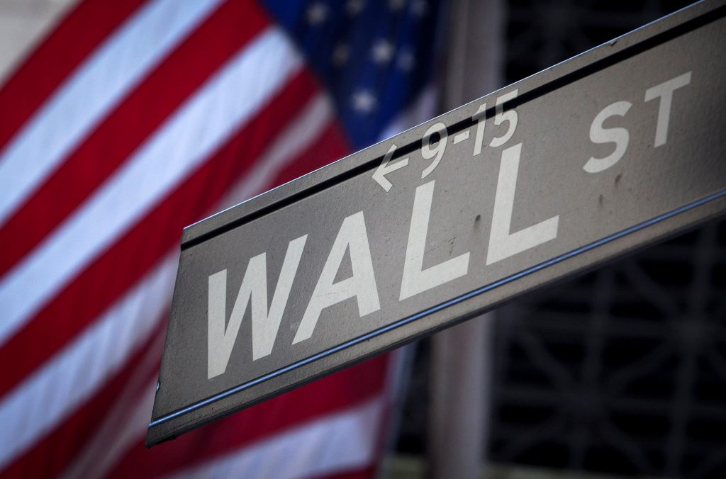 A Wall Street sign is pictured outside the New York Stock Exchange …