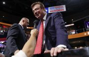 Republican U.S. presidential candidate Donald Trump's campaign manager Paul Manafort talks to the media from the Trump family box on the floor of the Republican National Convention in Cleveland, Ohio, U.S. July 18, 2016. REUTERS/Jonathan Ernst - RTSIMJC