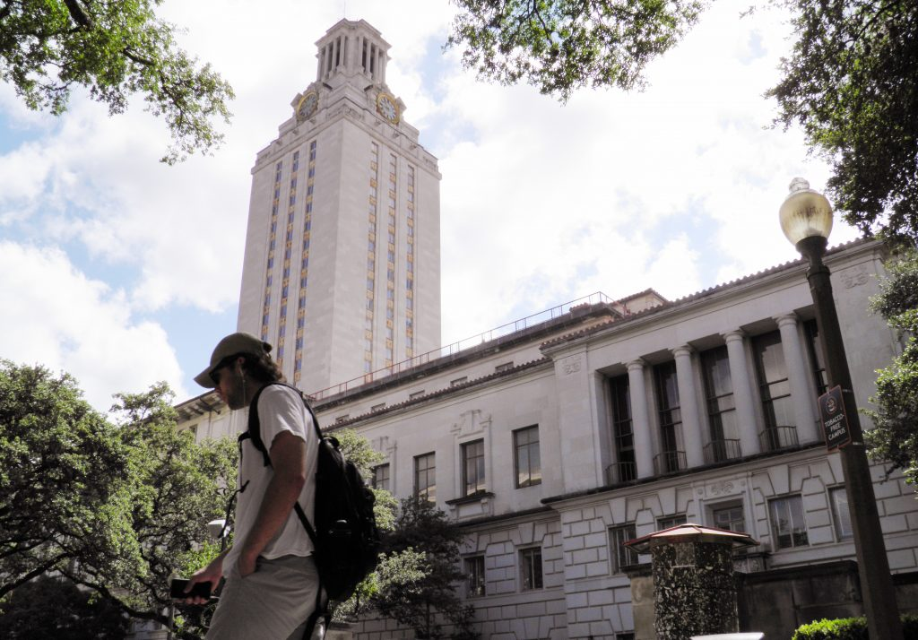 A student walks at the University of Texas campus in Austin.