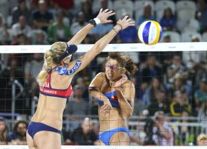 US beach volleyball player Kerri Walsh (left) wears kinesio tape during the 2016 Olympic Games. REUTERS/Ruben Sprich