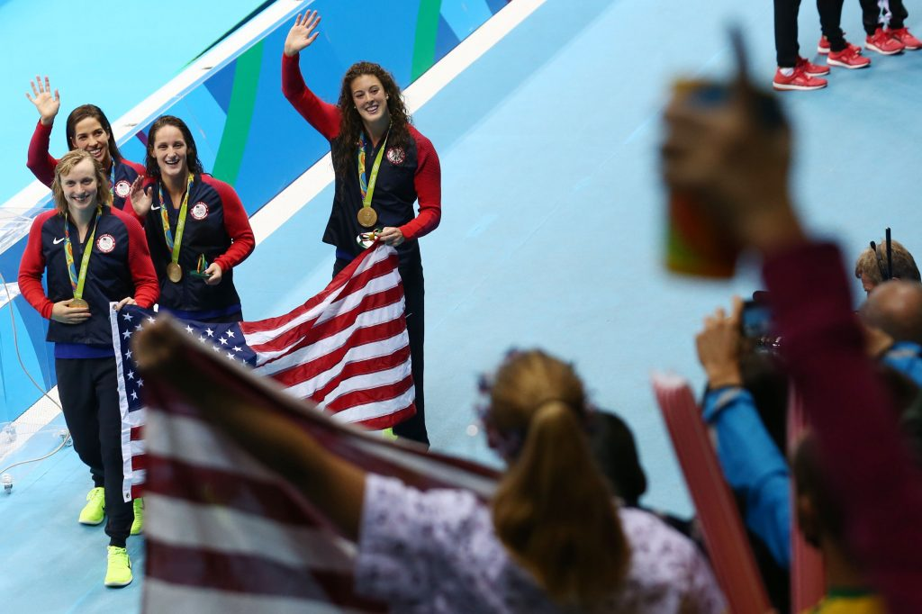 Allison Schmitt, Leah Smith, Maya DiRado and Katie Ledecky of the U.S. team wave to fans after receiving their gold medals. Photo by Marcos Brindicci/Reuters
