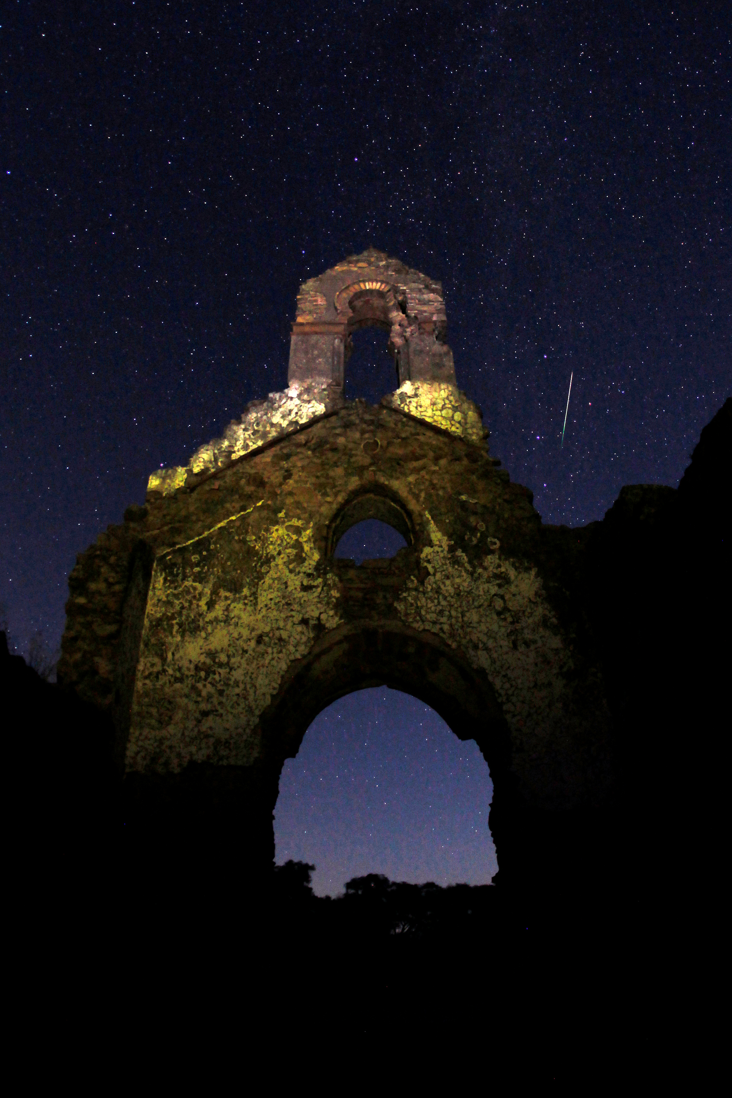 The Perseid meteor shower is seen above the ruins of a church in the Los Alcornocales nature park in La Sauceda, southern Spain. The meteors are so named because they appear to originate in the constellation Perseus. Photo by Jon Nazca/Reuters