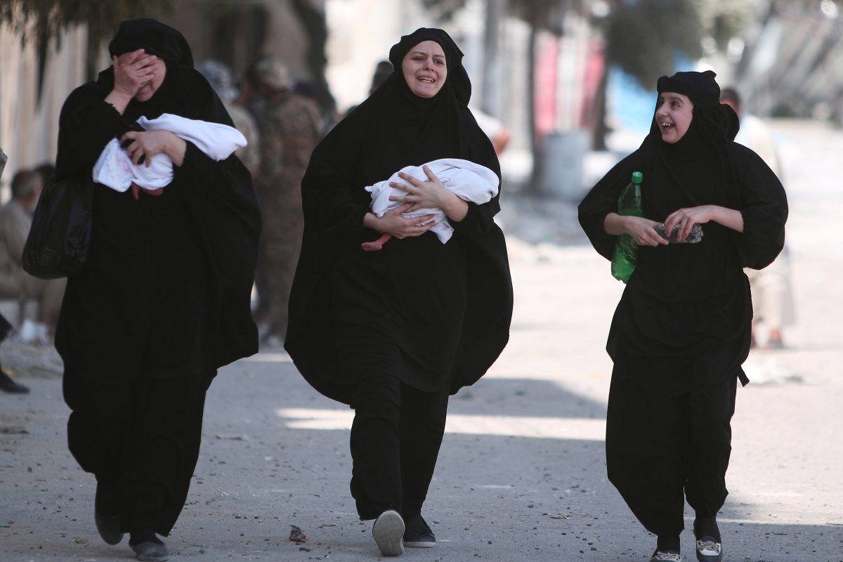 Women carry newborn babies while reacting after they were evacuated by the Syria Democratic Forces (SDF) fighters from an Islamic State-controlled neighbourhood of Manbij, in Aleppo Governorate, Syria, August 12, 2016. The SDF has said Islamic State was using civilians as human shields. REUTERS/Rodi Said TPX IMAGES OF THE DAY - RTSMZ4L