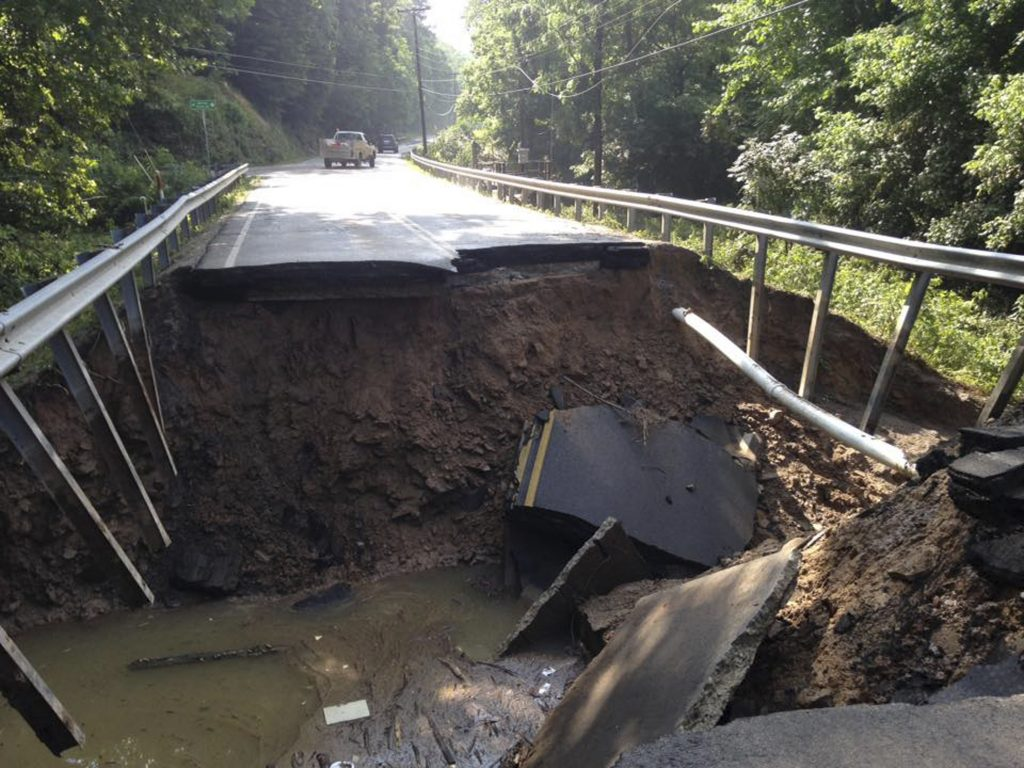 The West Virginia State Highway 4 along the Elk River shows extensive damage after flood water has dropped in the Clendenin, West Virginia on June 25. Image courtesy of the West Virginia Department of Transportation/Handout via Reuters