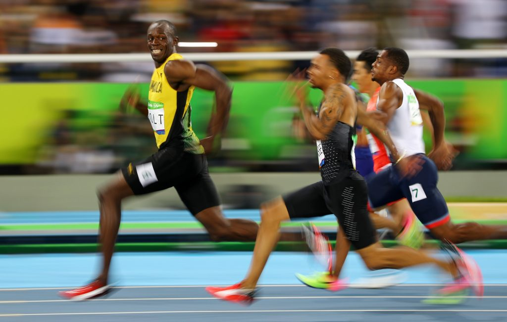 At the 2016 Rio Olympics during the men's 100m semifinals, Usain Bolt of Jamaica looks at Andre De Grasse of Canada as they compete. REUTERS/Kai Pfaffenbach