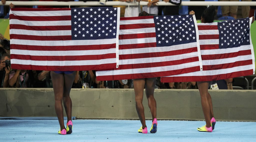 Team USA celebrates after they won gold, silver and bronze in the women's 100-meter hurdles. Photo by Phil Noble/Reuters