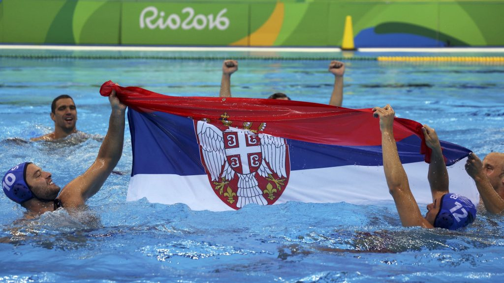 2016 Rio Olympics - Water Polo - Final - Men's Gold Medal Match Croatia v Serbia - Olympic Aquatics Stadium - Rio de Janeiro, Brazil - 20/08/2016. Serbian players celebrate gold medal win against Croatia. REUTERS/Sergio Moraes FOR EDITORIAL USE ONLY. NOT FOR SALE FOR MARKETING OR ADVERTISING CAMPAIGNS. - RTX2MD1F