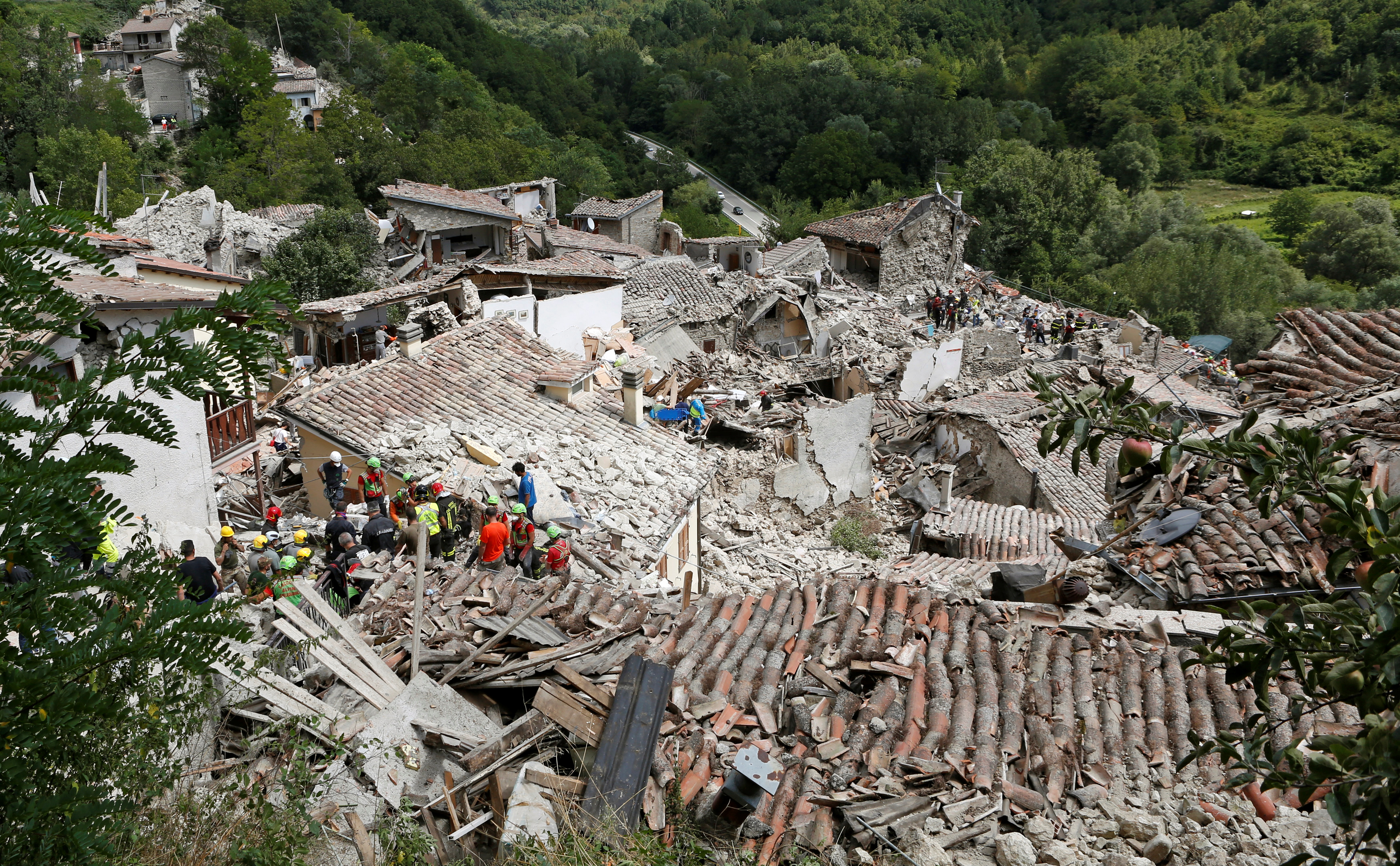 Rescuers work to free people from the rubble in Pescara del Tronto in central Italy on Wednesday. Photo by Remo Casilli/Reuters