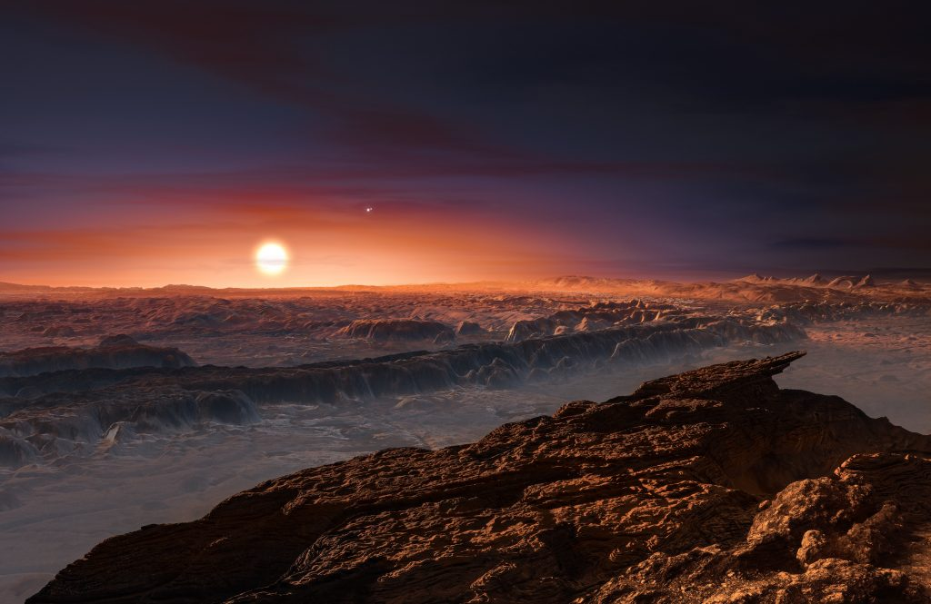 This artist's impression shows a view of the surface of the planet Proxima b orbiting the red dwarf star Proxima Centauri, the closest star to the Solar System. The double star Alpha Centauri AB also appears in the image to the upper-right of Proxima itself. Proxima b is a little more massive than the Earth and orbits in the habitable zone around Proxima Centauri, where the temperature is suitable for liquid water to exist on its surface. Photo by ESO./L. Calçada/Nick Risinger