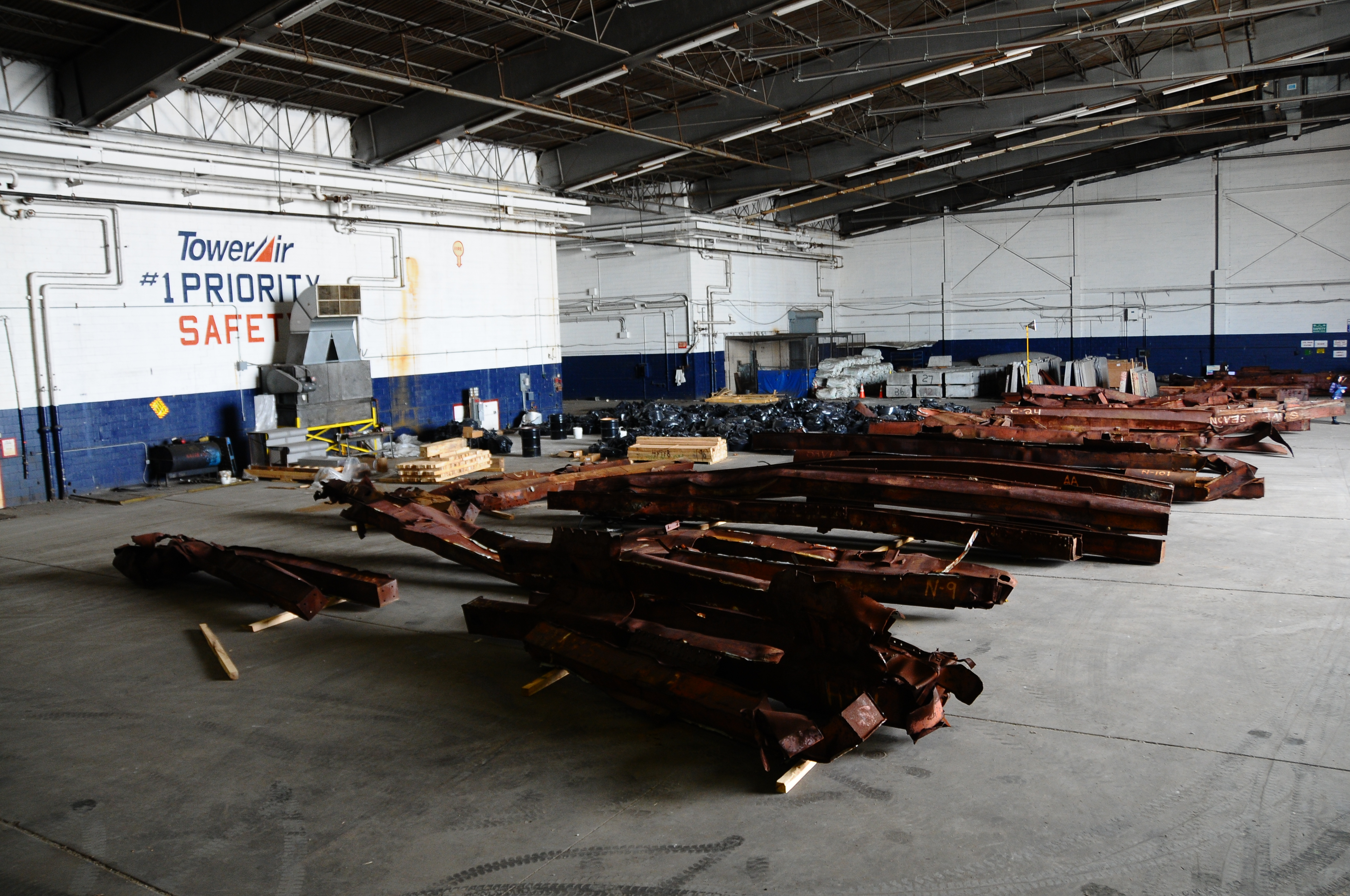 Steel beams analyzed by the National Institute of Standards and Technology rest inside a hangar once occupied by TKTK at JFK airport in New York.