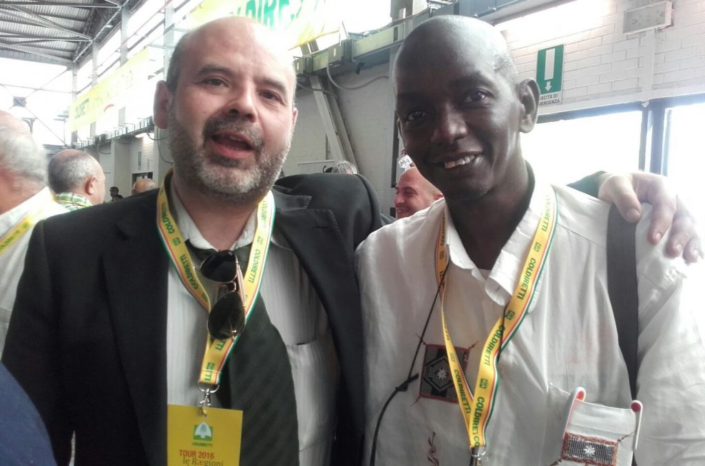Cheikh Diankha and Luca Pintus attend a Coldiretti farmers union event. Photo provided by Luca Pintus