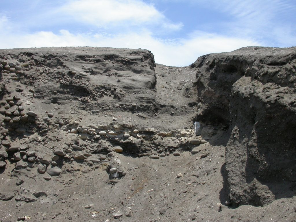 Trench dug by Junius Bird in the late 1940s. Textiles are visibly embedded in the mound. Photo by Jefrey C. Splitstoser.