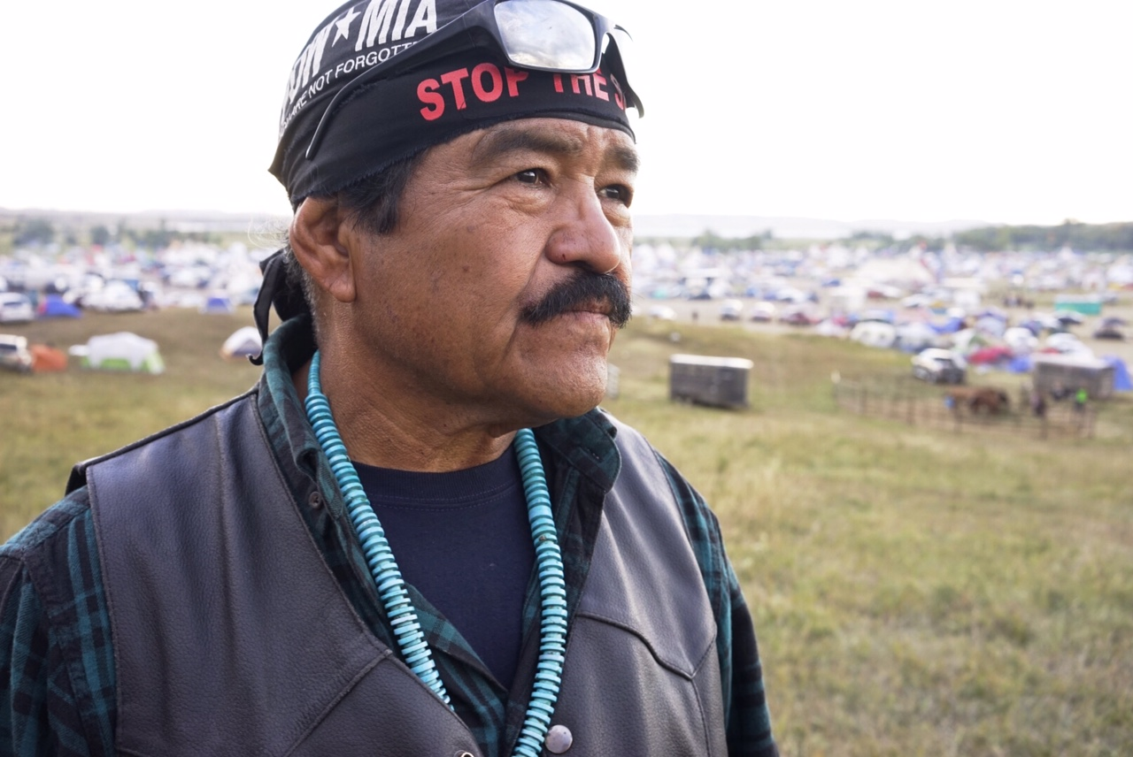"""We have been fighting this fight for generations,"" says Seeyouma Na Hash-Chid. He rode his motorcycle out from Arizona to support the Standing Rock tribe's protest against an oil pipeline. Na Hash-Chid is a Dine (Navajo), a Vietnam vet, and a veteran of earlier environmental fights back home in Arizona. He says people will stay at this vast protest camp through the winter to guarantee the pipeline never gets built. Photo by William Brangham"