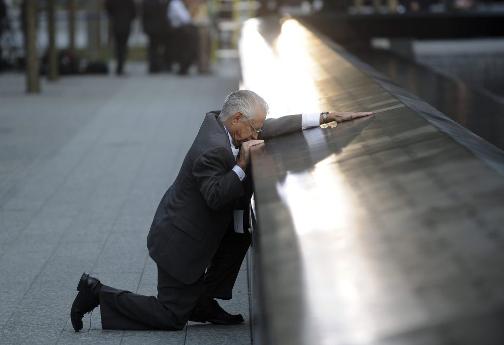 Robert Peraza, who lost his son Robert David Peraza, pauses at his son's name at the North Pool of the 9/11 Memorial during tenth anniversary ceremonies at the site of the World Trade Center in New York. Photo by Justin Lane/Reuters