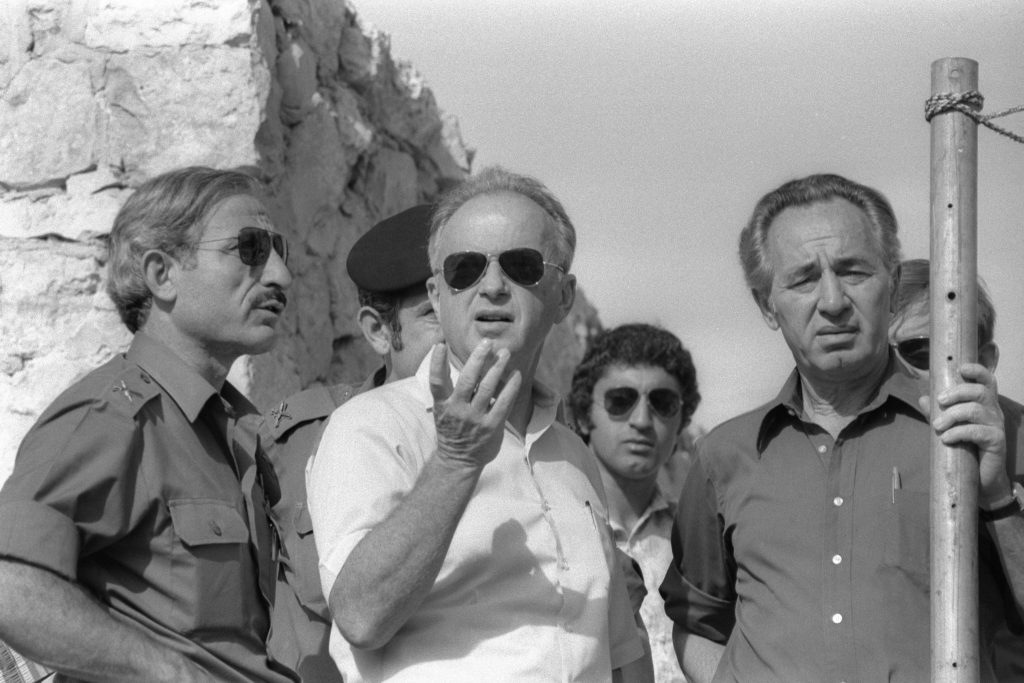 Israel's Defense Minister Shimon Peres (right) and Prime Minister Yitzhak Rabin (center) visit the ruins of a synagogue in the West Bank City of Hebron on Oct. 15, 1976 in this handout photo released by the Israeli Government Press Office. Photo by Ya'acov Sa'ar/Handout/GPO via Reuters