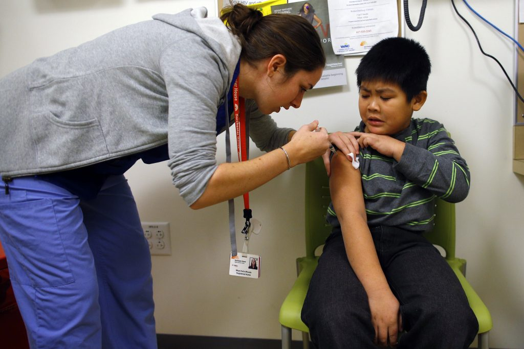 A nurse at a clinic in Boston gives a child an influenza vaccine injection. Photo by Brian Snyder/Reuters.