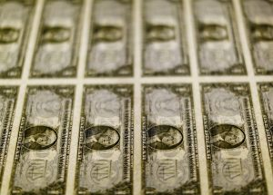 United States one dollar bills seen on a light table at the Bureau of Engraving and Printing in Washington