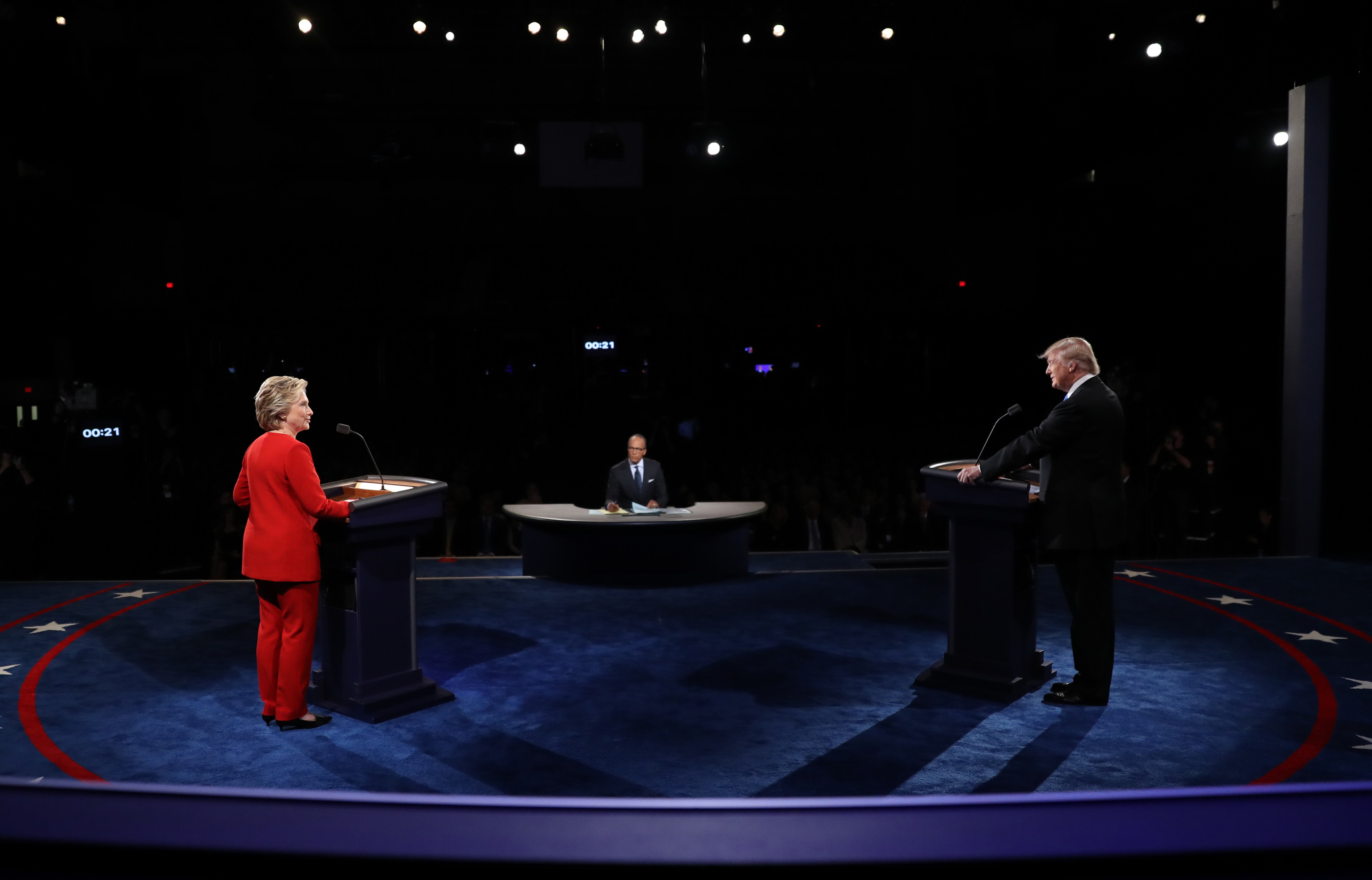 Republican U.S. presidential nominee Donald Trump and Democratic U.S. presidential nominee Hillary Clinton discuss a point during their first presidential debate at Hofstra University in Hempstead, New York, U.S., September 26, 2016. REUTERS/Joe Raedle/Pool  - RTSPKCQ