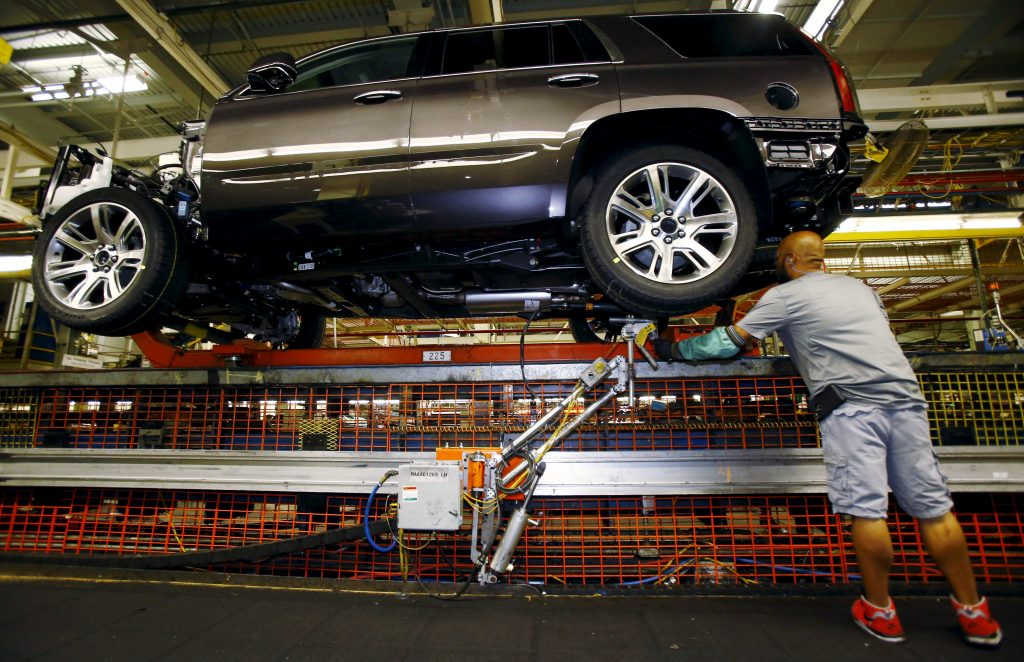 Mike Guillen works on the assembly line at the General Motors Assembly Plant in Arlington, Texas June 9, 2015. General Motors Co is raising the stakes on its bet that sales of fuel-thirsty sport utility vehicles will keep driving its global profits as Chinese and other markets sag. GM said on July 14, 2015 that it plans to spend $1.4 billion to modernize the factory in Arlington, Texas, that builds the Cadillac Escalade, Chevrolet Suburban and GMC Yukon sport utility vehicles. It's the largest single investment in a $5.4 billion, three-year plant upgrade program announced earlier this year. Picture taken June 9, 2015. To match Insight GM-SUVS/ REUTERS/Mike Stone